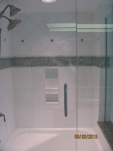 Bathroom 4 - Ceramic tub surround with border containing glass tile  accents, glass tile backsplash and ceramic tile floor